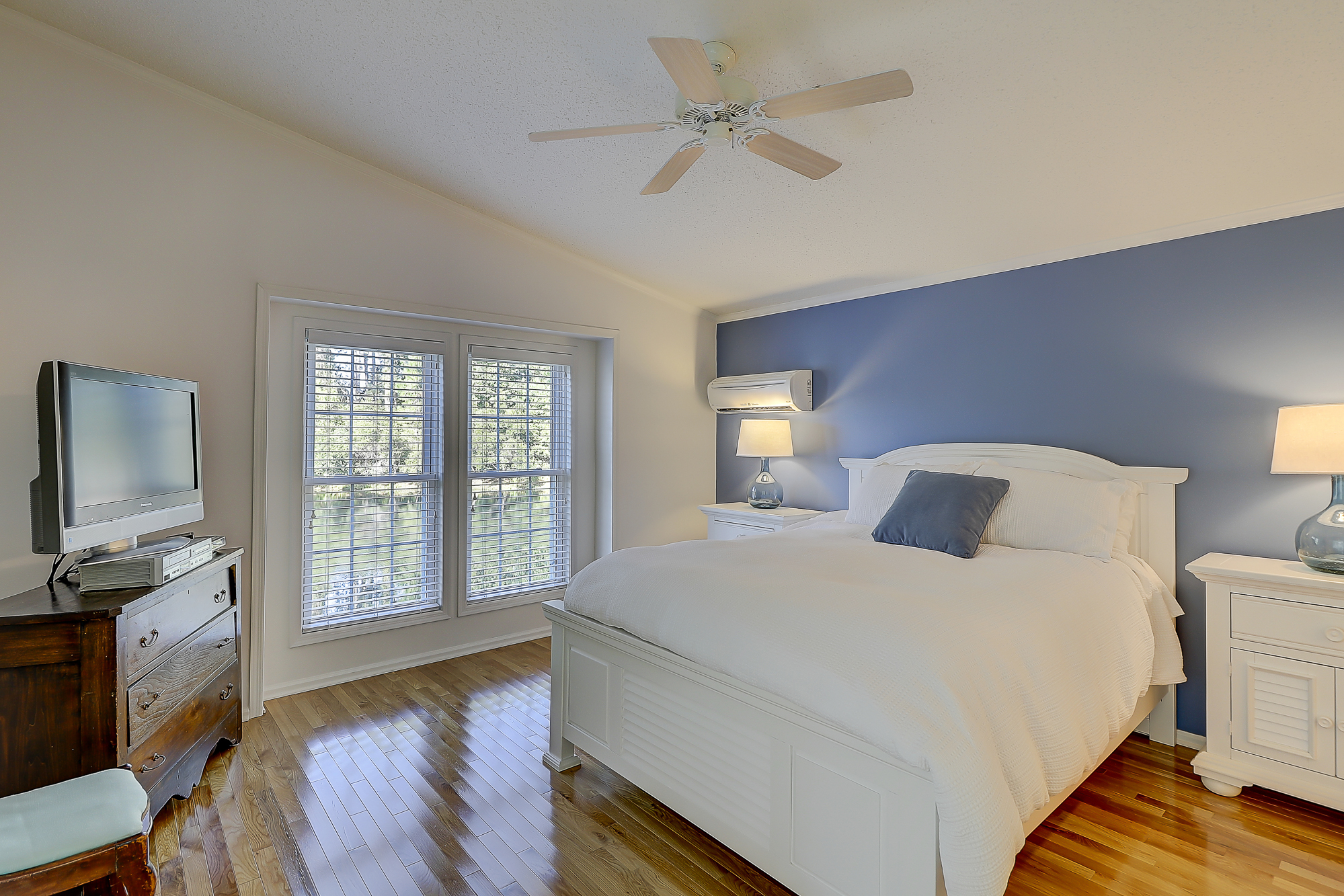 Master Bedroom with Hardwoods and Access to the Screen Porch.