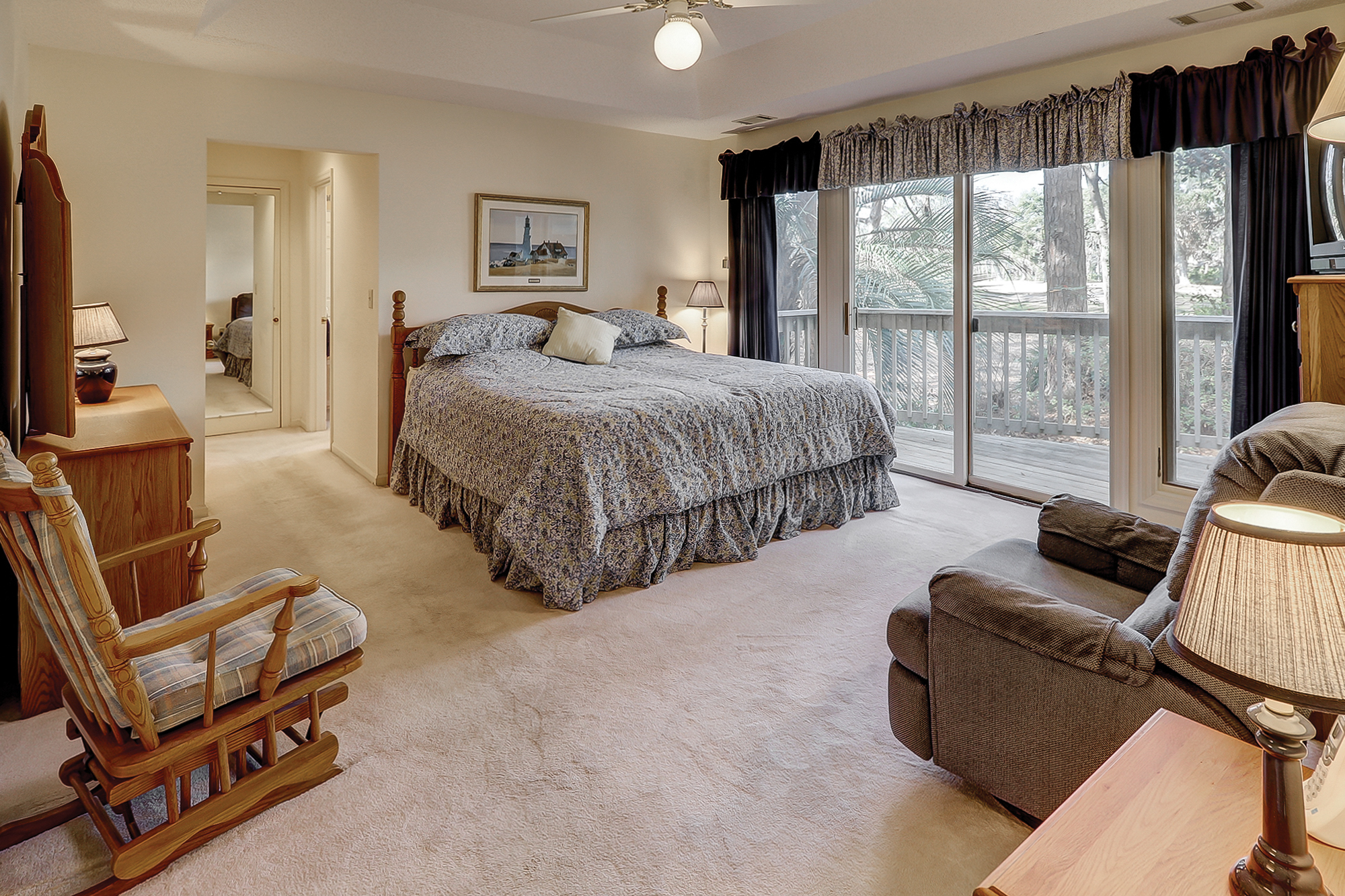Master Bedroom on the Main Level with Access to a Private Deck and Views of Shipyard Golf