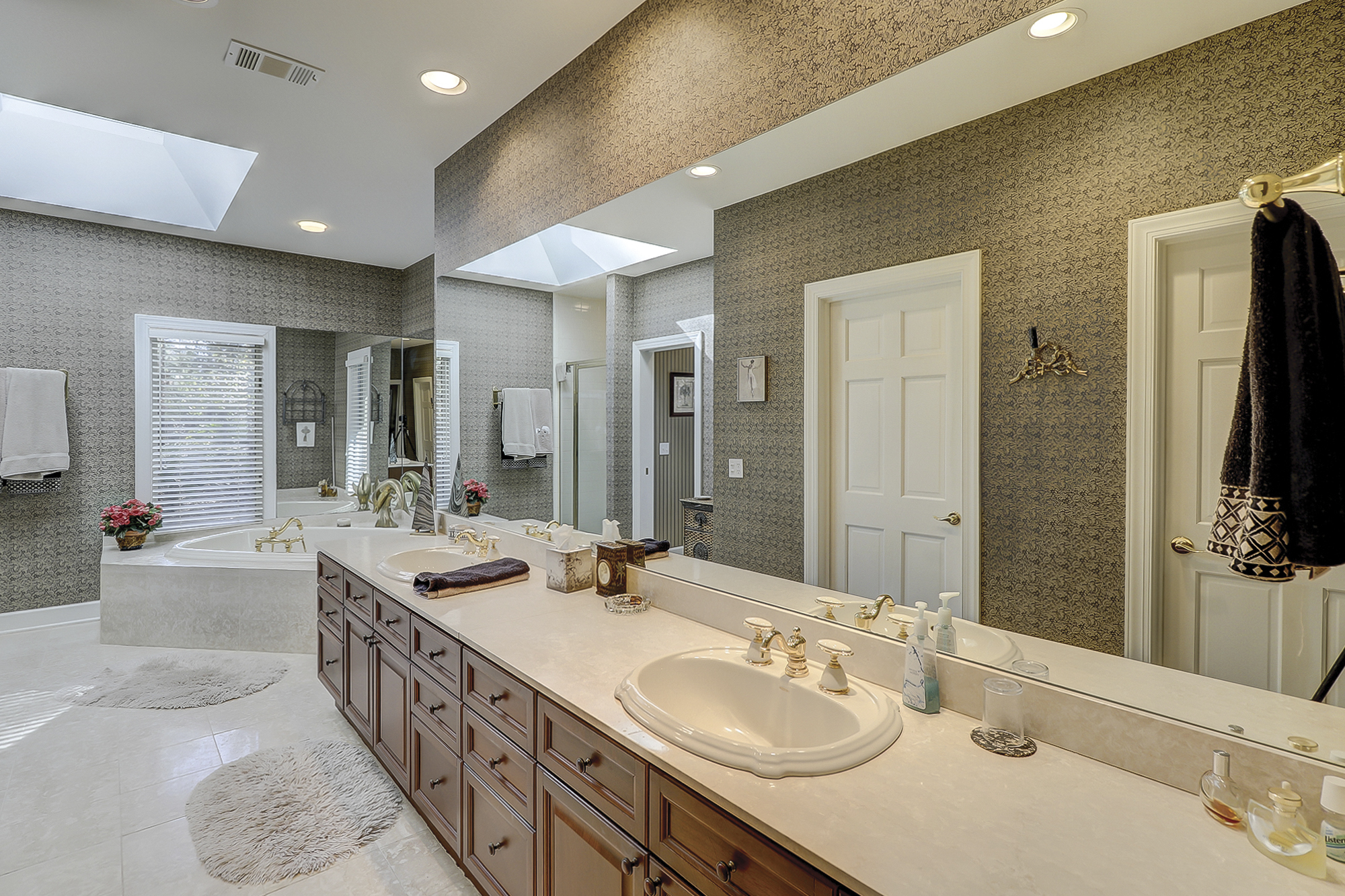 Luxury Master Bath with His and Her Vanity and Walk In Closets, Jetted Tub, Separate Shower and a Private Water Closet