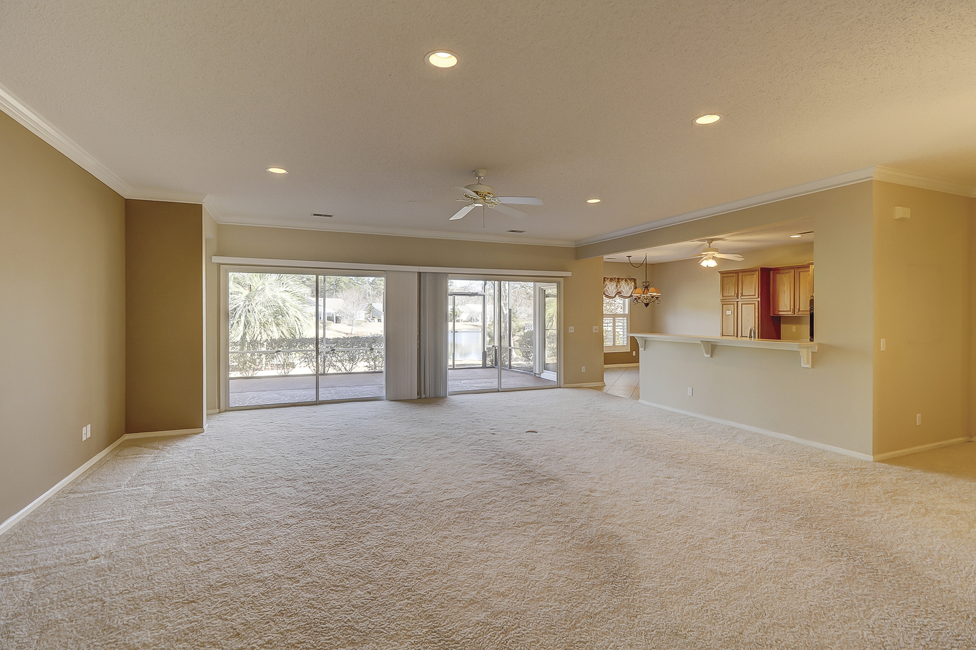 WOW, this Great Room is huge and open to the Kitchen, Dining Room, Breakfast Room and the expansive Lanai just adds more living space. Sun City