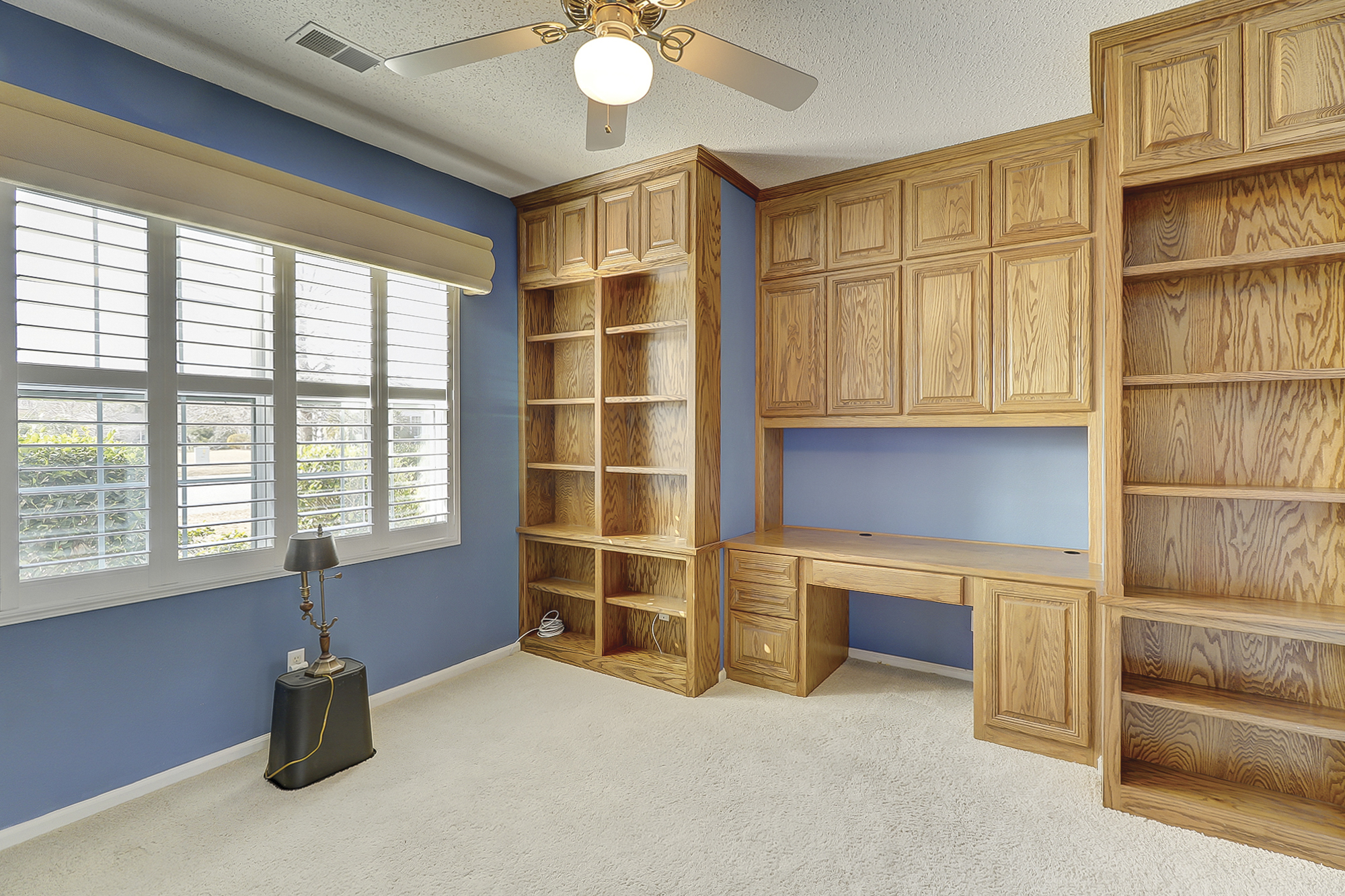 The Den is fitted with custom Oak Built-ins and desk. There is high quality carpet throughout.