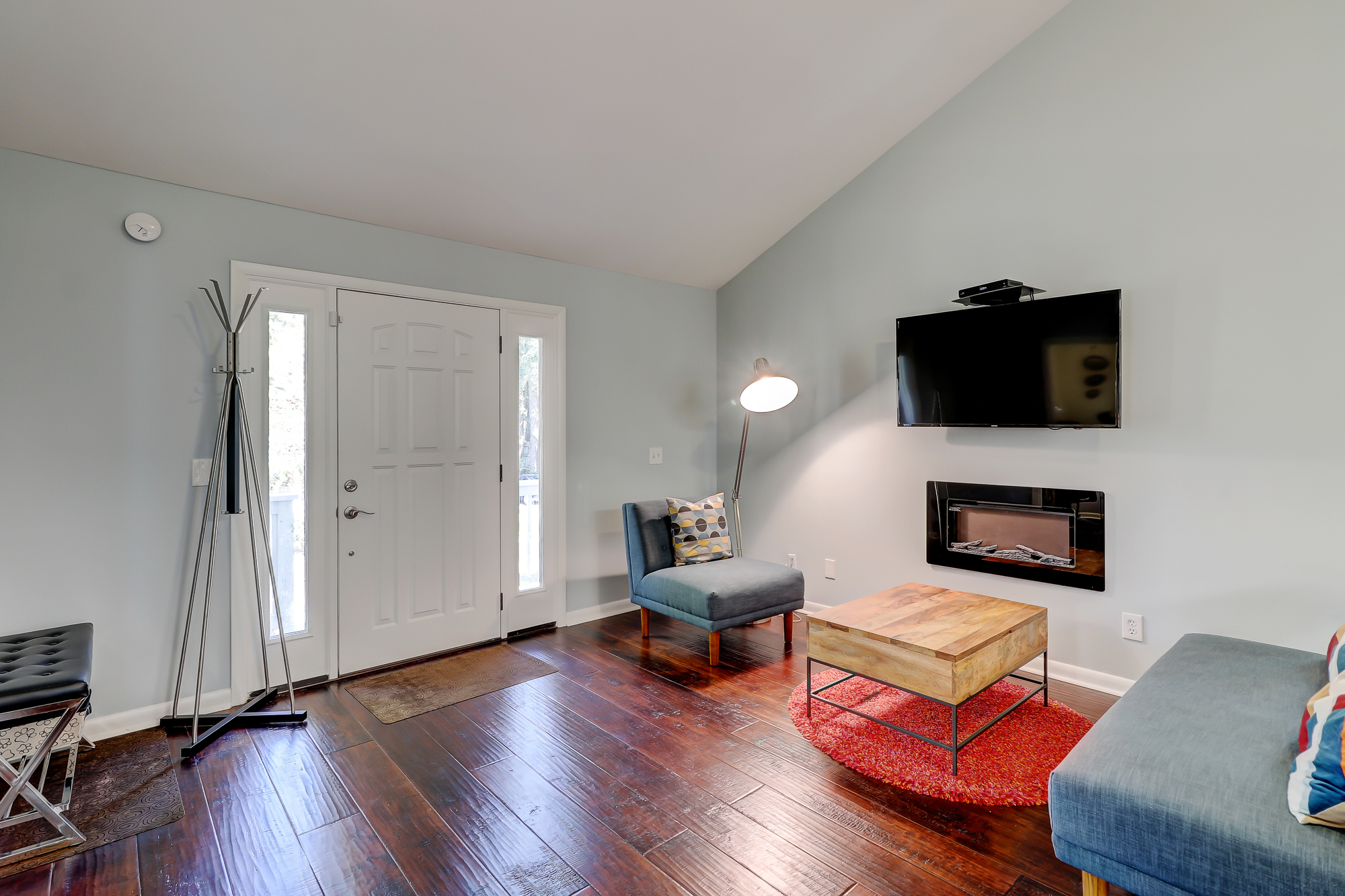 Handscraped hardwoods, cathedral ceiling, fireplace, wall mounted TV and all in perfect condition. 8 Bradley Beach, Hilton Head Island, MLS# 388240
