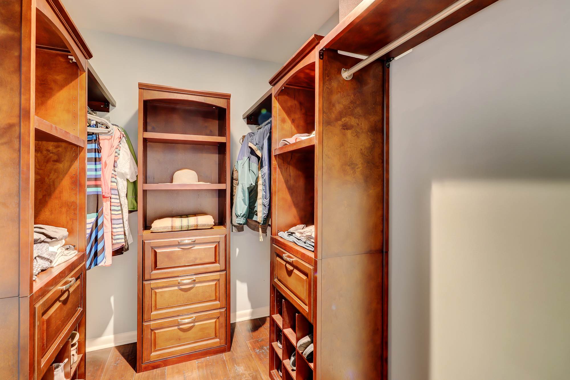 Master walk in closet with wood shelving, drawer bases, shoe racks and hardwoods. 8 Bradley Beach, Hilton Head Island, MLS# 388240