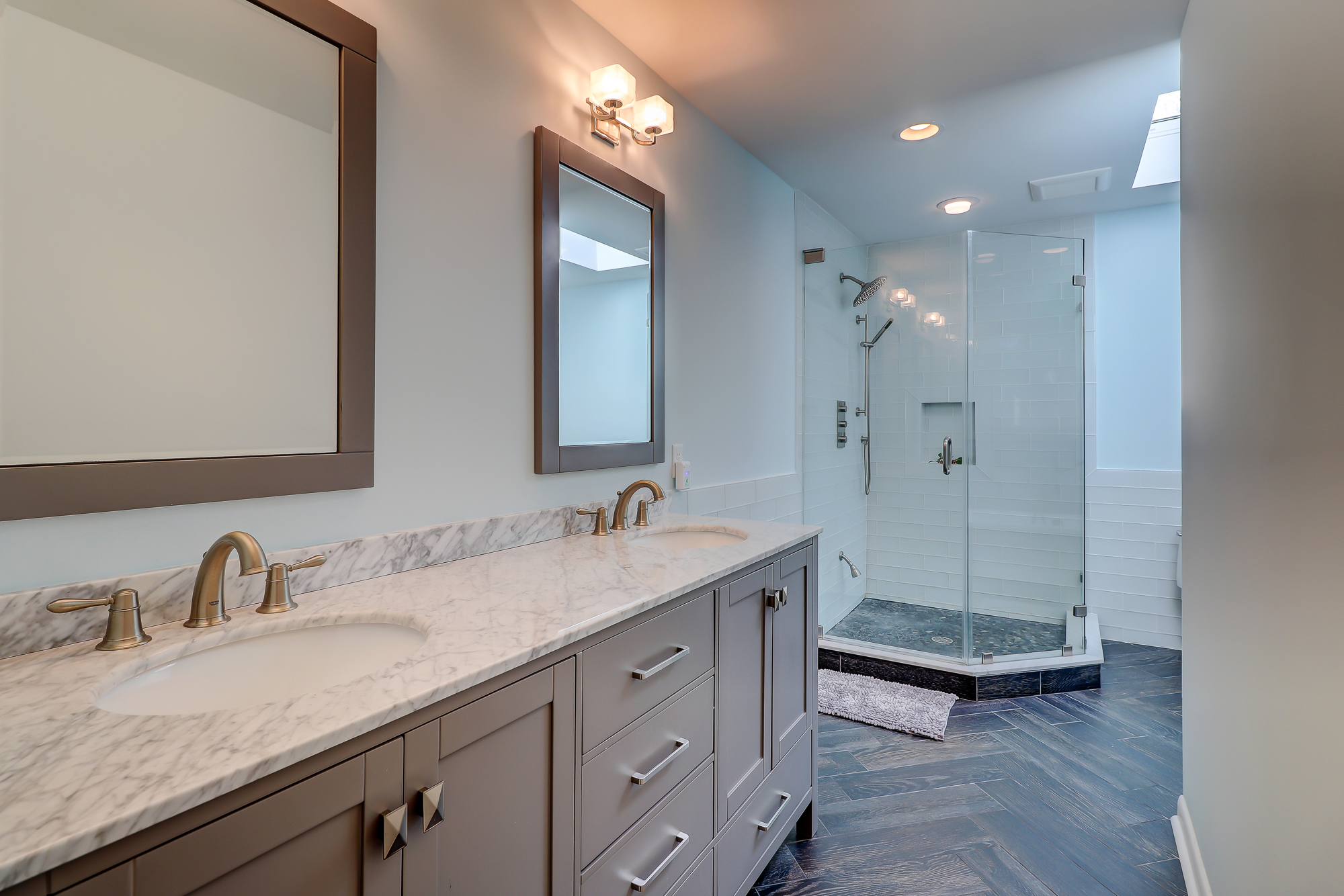 His and her vanity, custom furniture quality cabinets, glass tile shower and herringbone tile floor. 8 Bradley Beach, Hilton Head Island, MLS# 388240