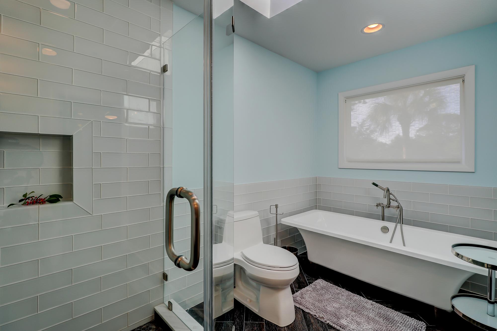 Glass Tile wainscoting, frameless shower enclosure and a soaking tub.