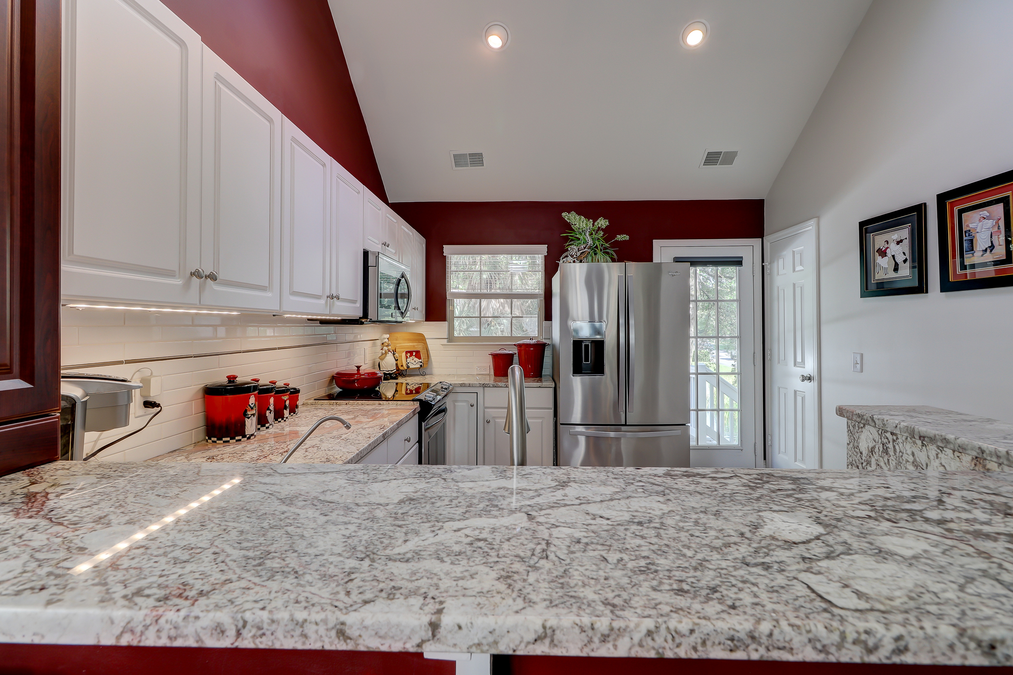 Granite Counter Tops, Stainless Steel Appliances and High Cathedral Ceiling