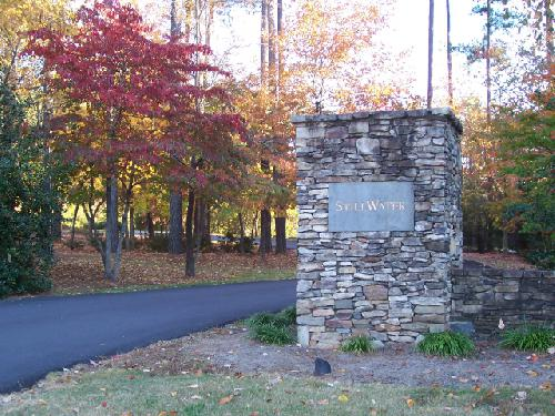Entrance to Stillwater, A Woodland Lake Community