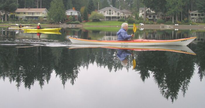 Kayaking at Lake Limerick is not just for the young! Notice the glass or mirror of the lake.