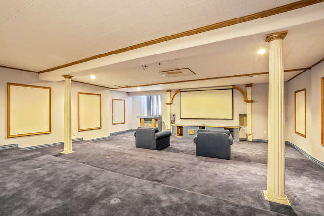 Indoor theater, 10 Sunrise Drive, Englewood, CO -  listed with Friedman Realty Associates