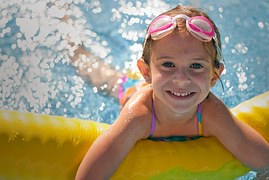 Homes for sale with a pool Tampa FL, Tampa Pool Homes for sale, Pool homes for sale in Tampa, Kids playing in the pool, Pricing Trends in Tampa Housing Market