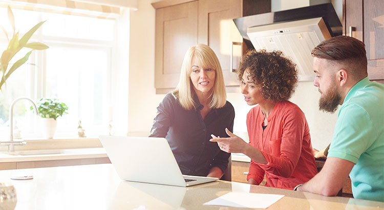 Picture of Real Estate Agent presenting information to a couple