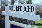 home price reduced sign