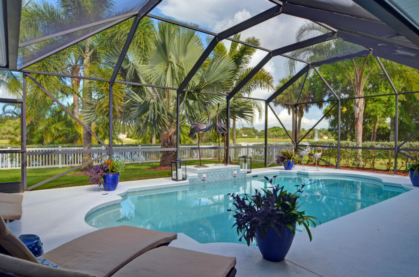 LUXURY GATED LAKEFRONT POOL HOME IN GATED HUNTERS RUN VERO BEACH FL WITH IN-LAW/GUEST WING