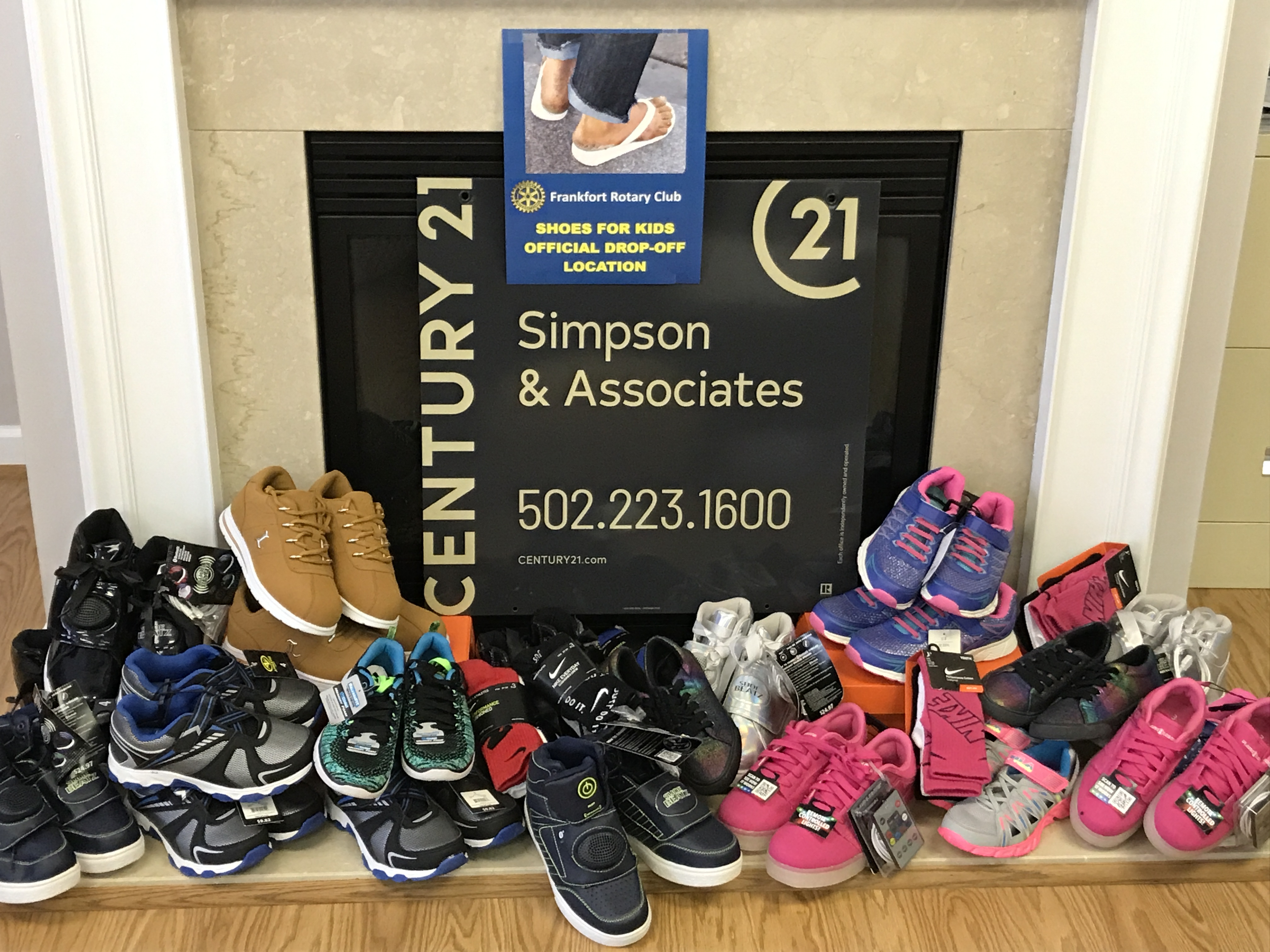 Frankfort Rotary Shoes For KIds Drive Donations from CENTURY 21 Simpson & Associates