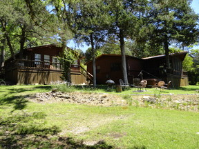 Single Family Home UNCLE FUZZY'S 3 CABINS: 10921 Lathams Landing (all)