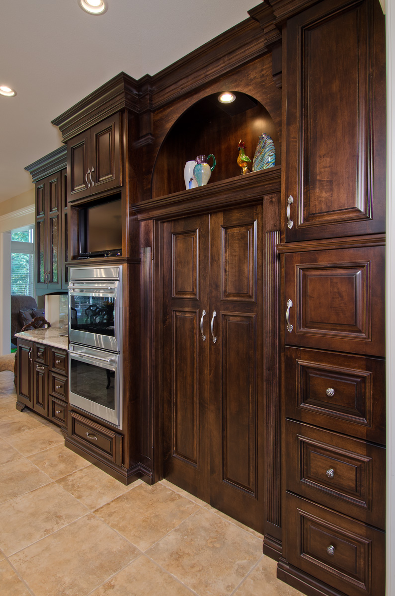 Can you find it? Cabinetry can conceal a walk-in pantry entry.
