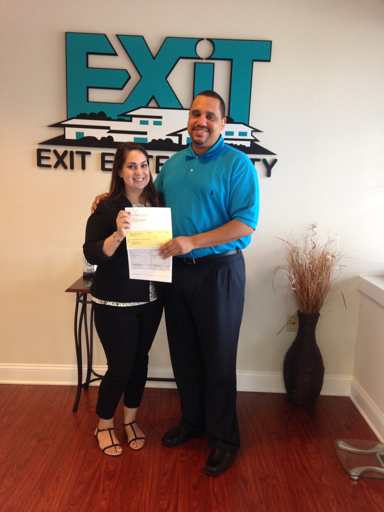 Exit Elite Realty Broker Koy Banks congratulated me on my first solo Commission Check!