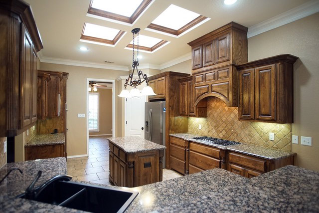 Open Kitchen with Beautiful Skylight Brightens the Spacious Kitchen