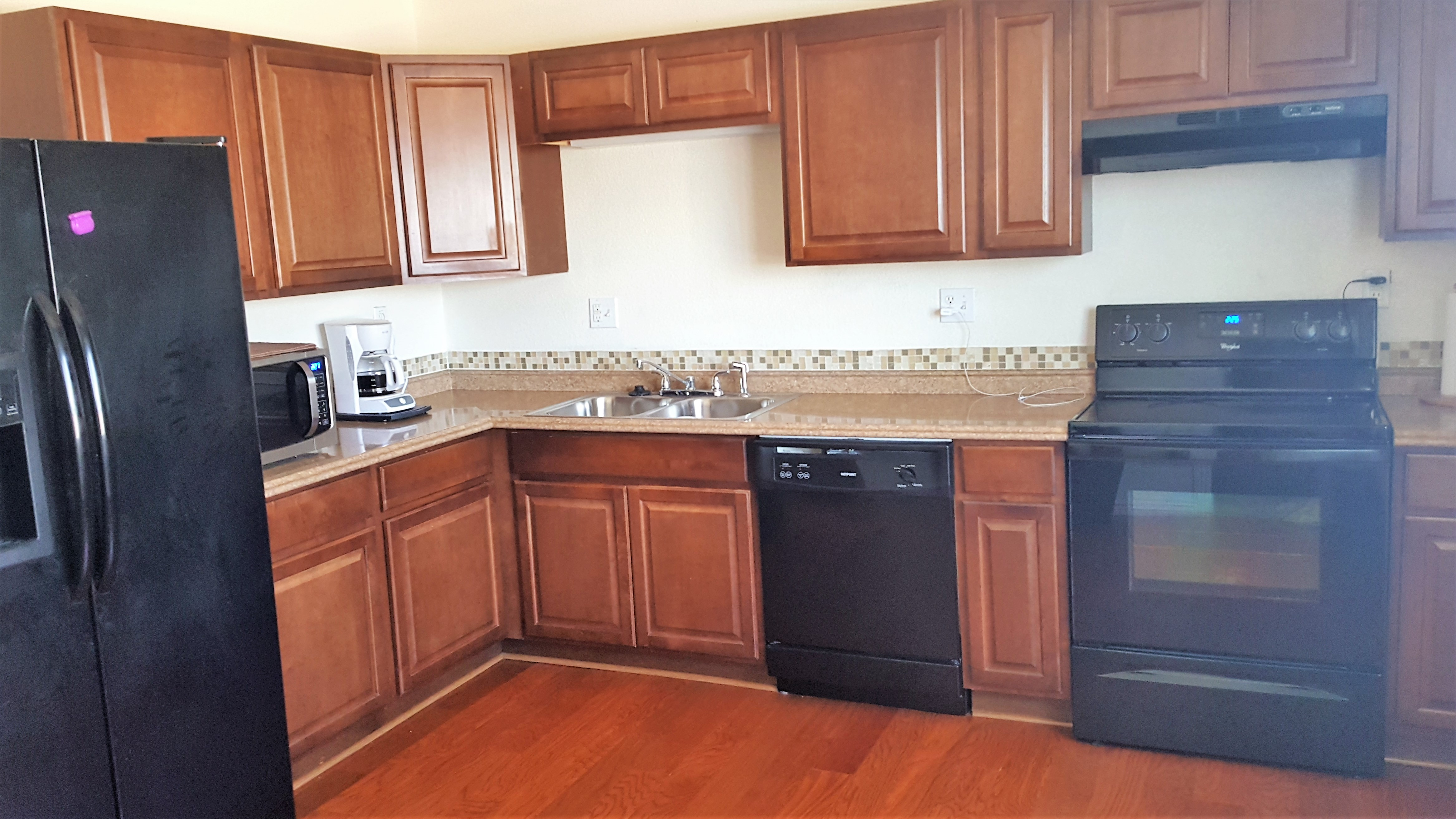 Upgraded cabinets and counters in this Brighton Ranch Style Home