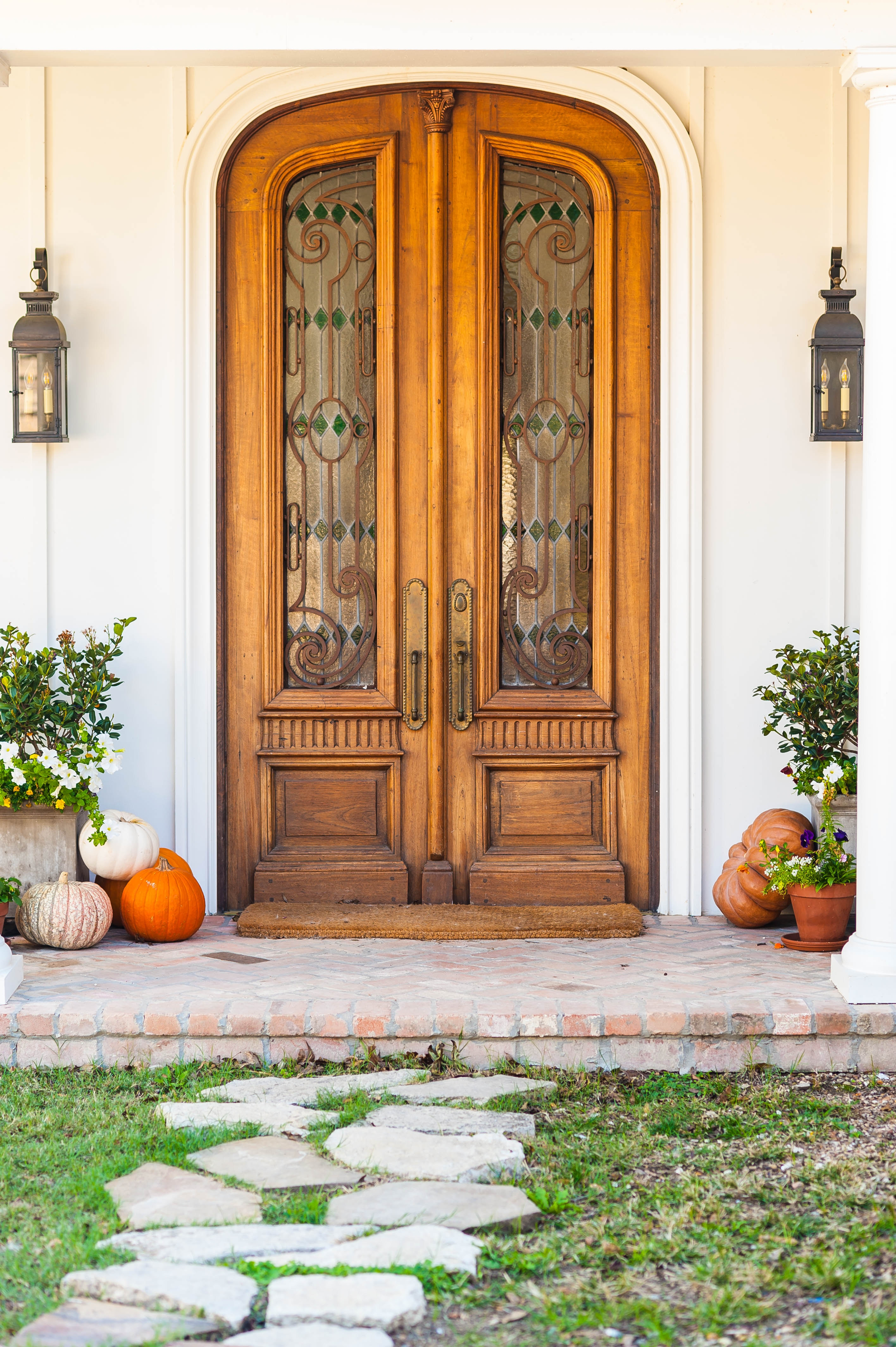 Photogrpah of front door of home with pumpkins