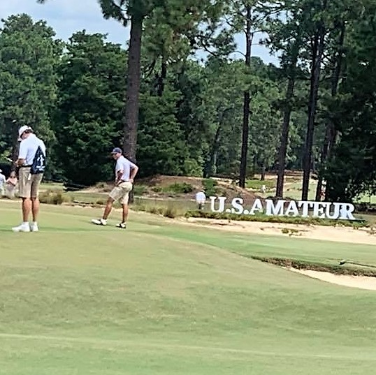 Golfers on a golfing green