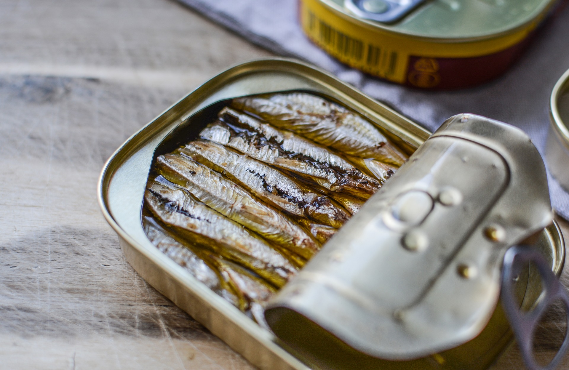 A can with sardines, a small fish