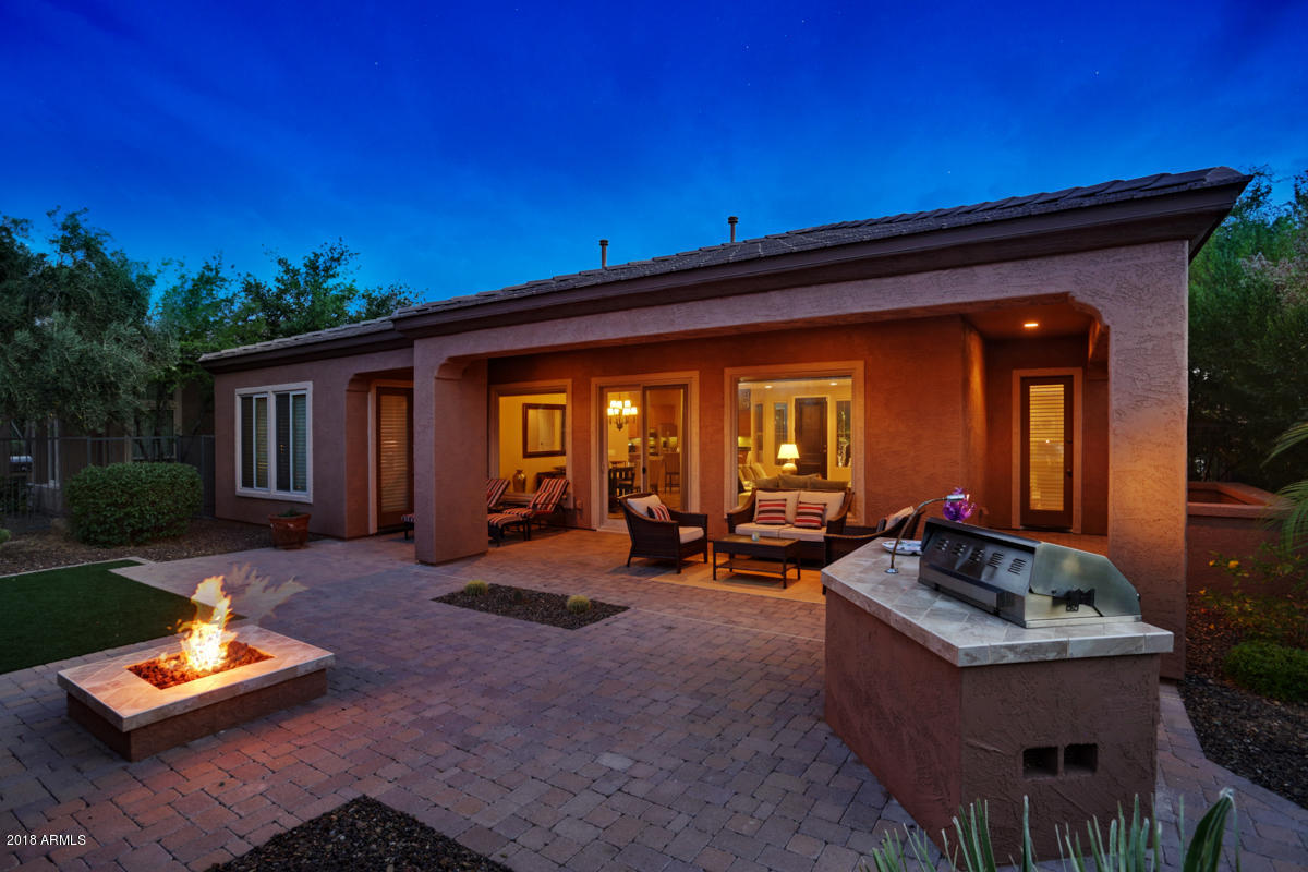 Friedman Realty Associates, 28415 N. 130th Dr., back patio with BBQ, firepit, spectacular sunsets