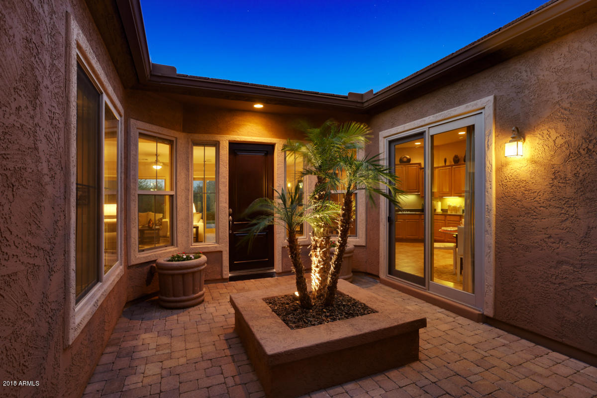 Friedman Realty Associates, 28415 N. 130th Dr., front courtyard view at twilight