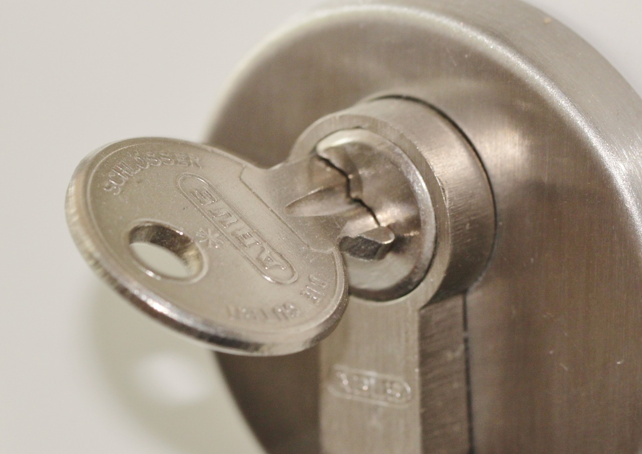 Friedman Realty Associates, single key in the lock of a door