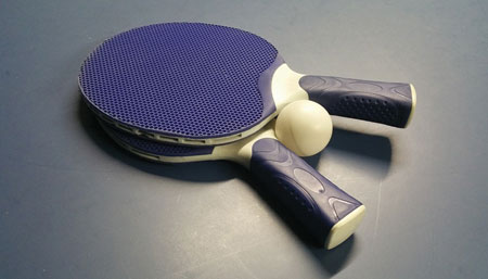 Ping-Pong paddles on a table.