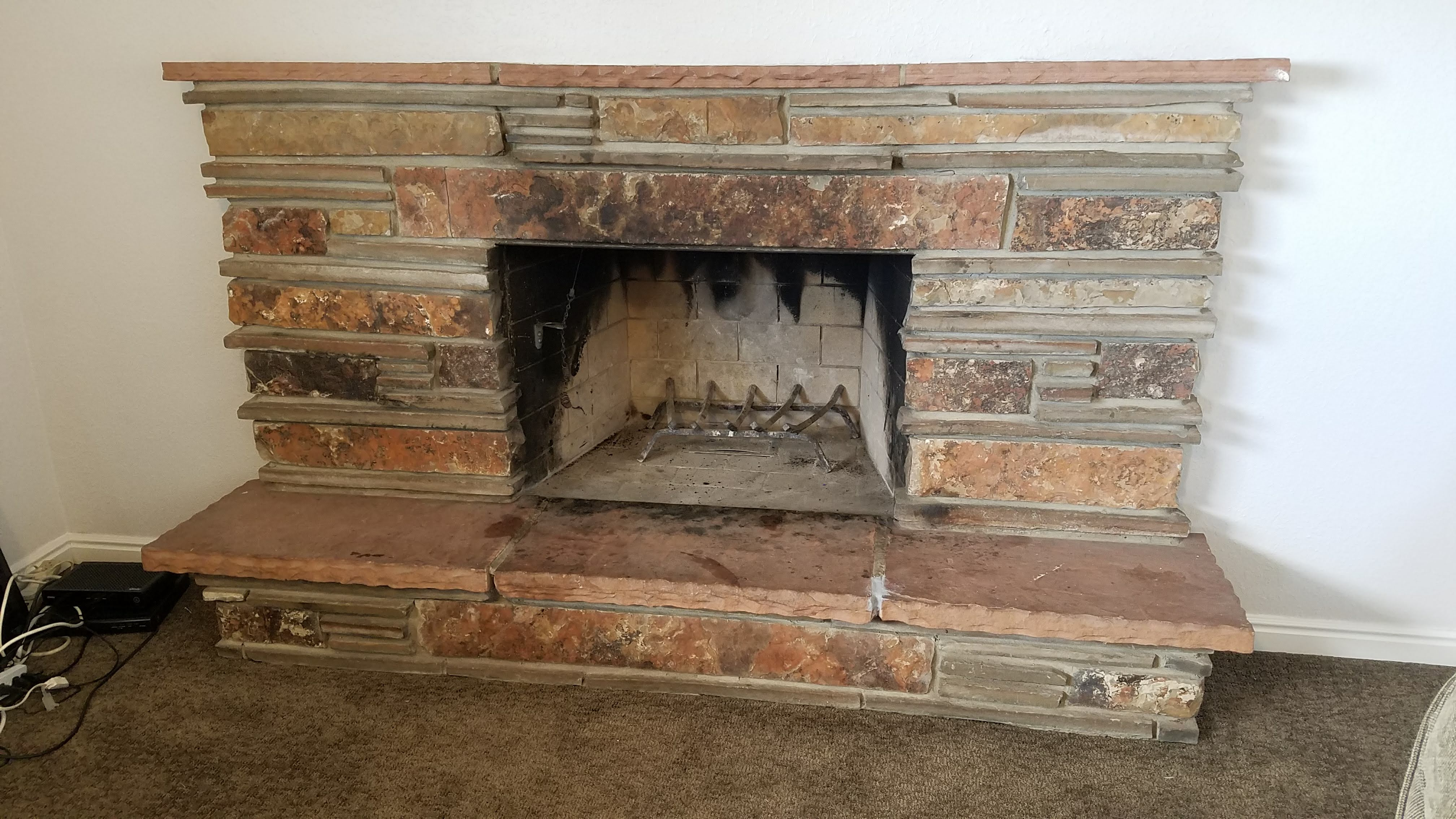 Red stacked rock fireplace