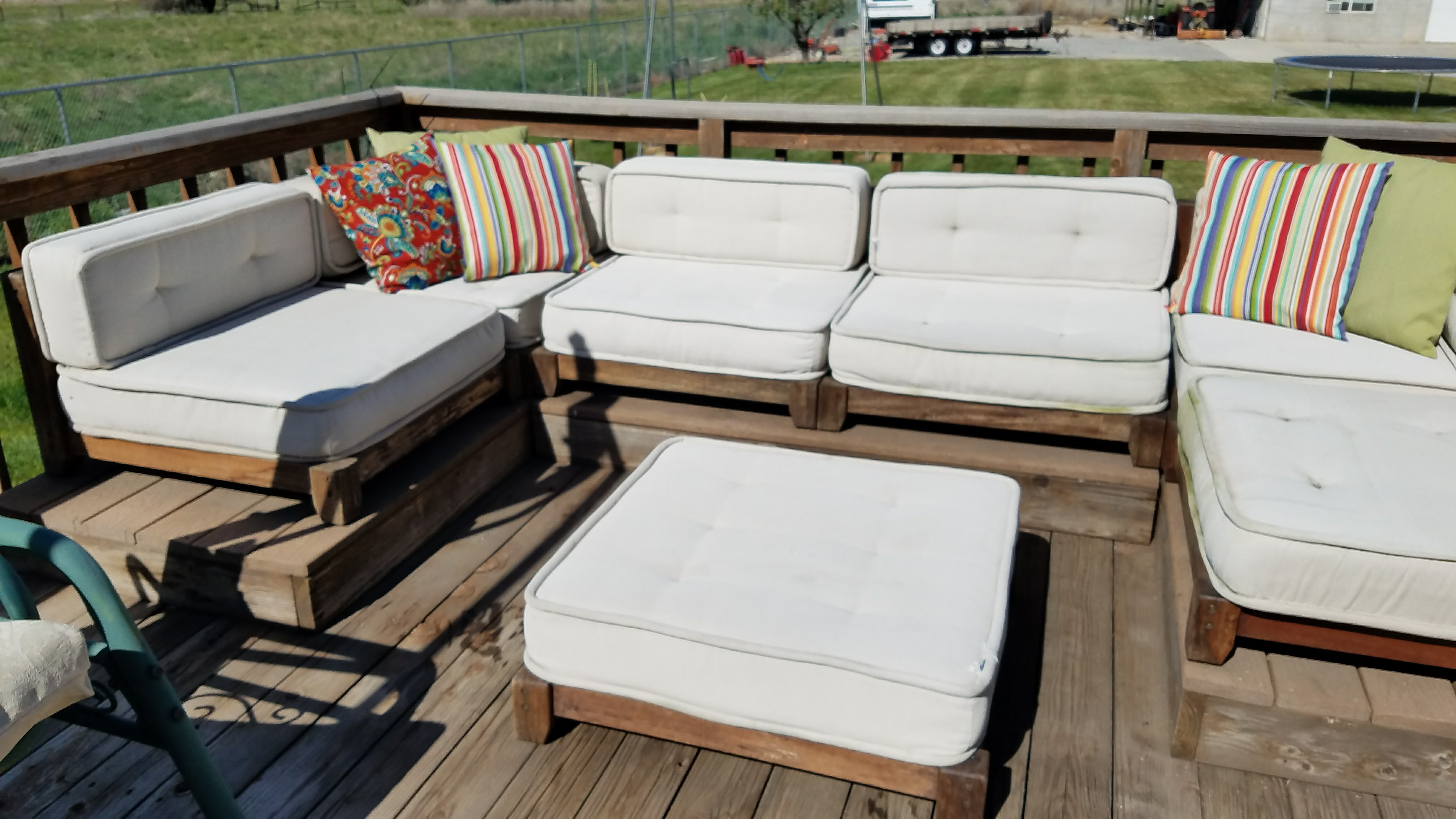 The patio furniture assembled with clean white cushions.