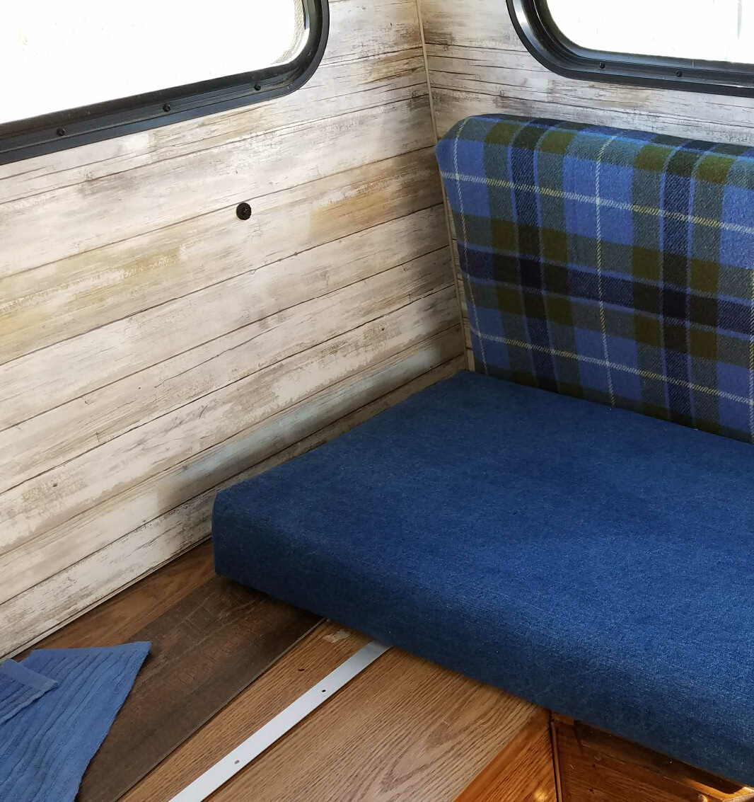 Wool and denim for seat cushions.
