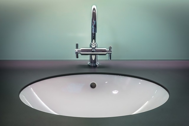 A clean bathroom sink and surrounding surface.