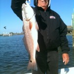 "Mr Darwin Weinke with a nice 30"" redfish."