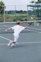 Boy playing tennis.JPG