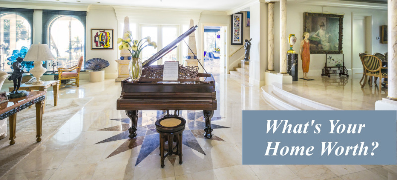 Photo of a grand piano in the center of an opulent room with white granite floors