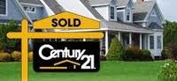 CENTURY 21 sold sign in front of a house.