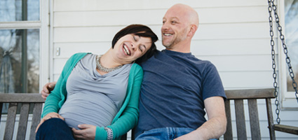Couple on front porch of rental home