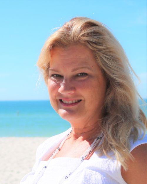 Diana Sinisi, Real Estate Salesperson