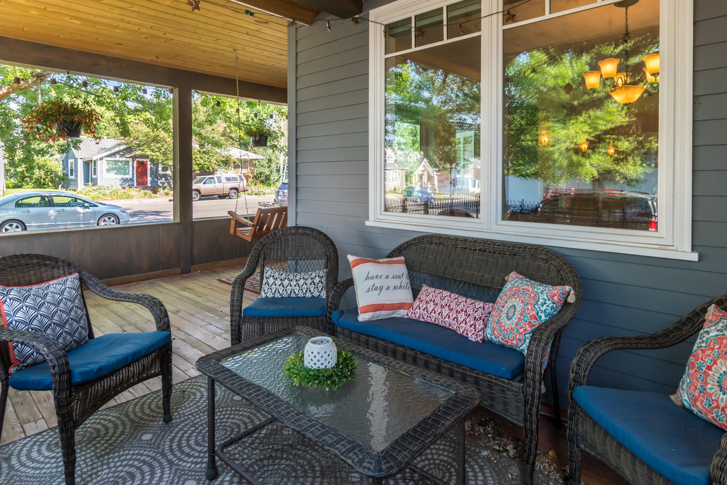 Wrap around porch with outdoor furniture and pillows