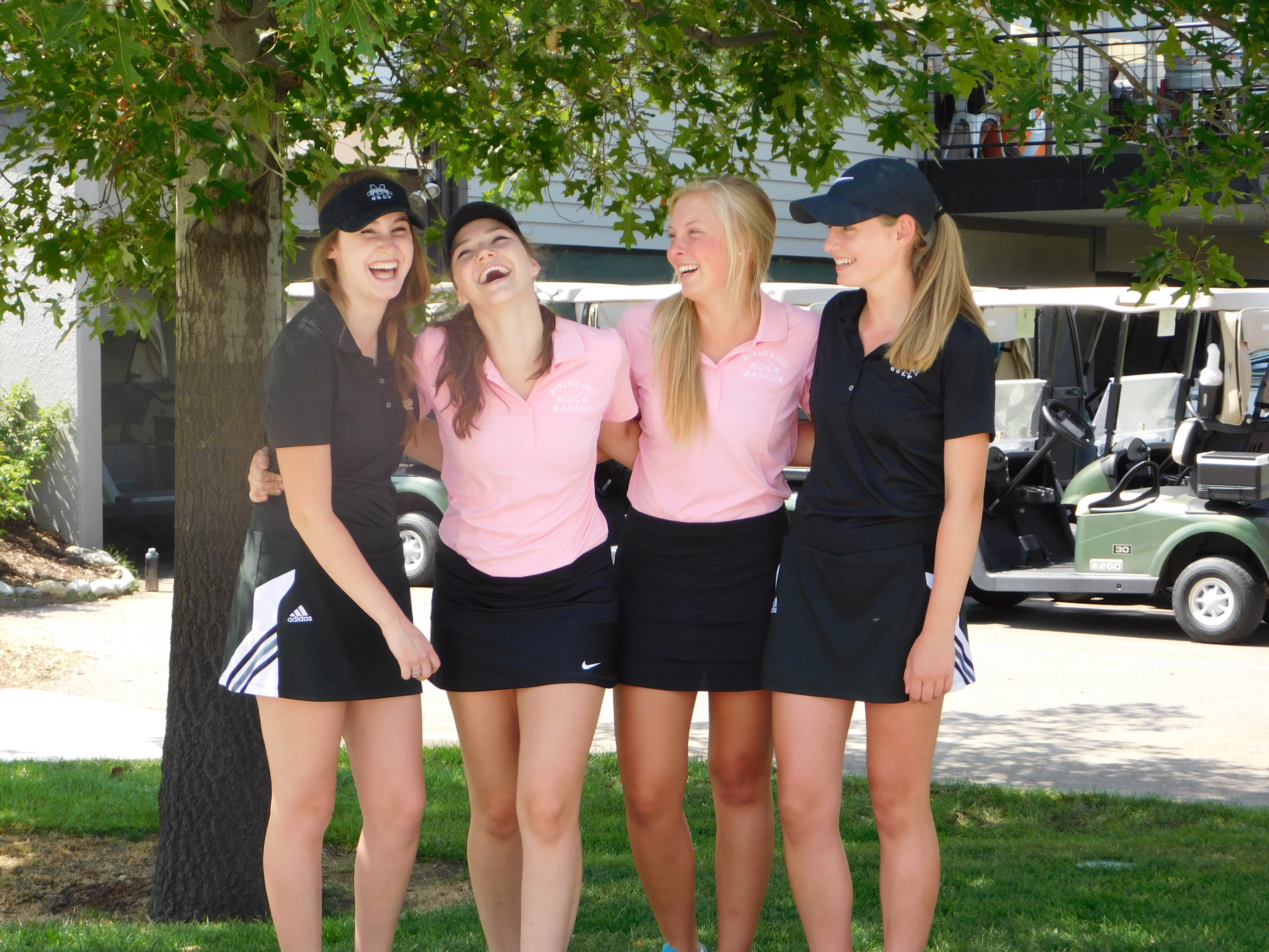 4 young women after a round of golf laughing at Coal Creek