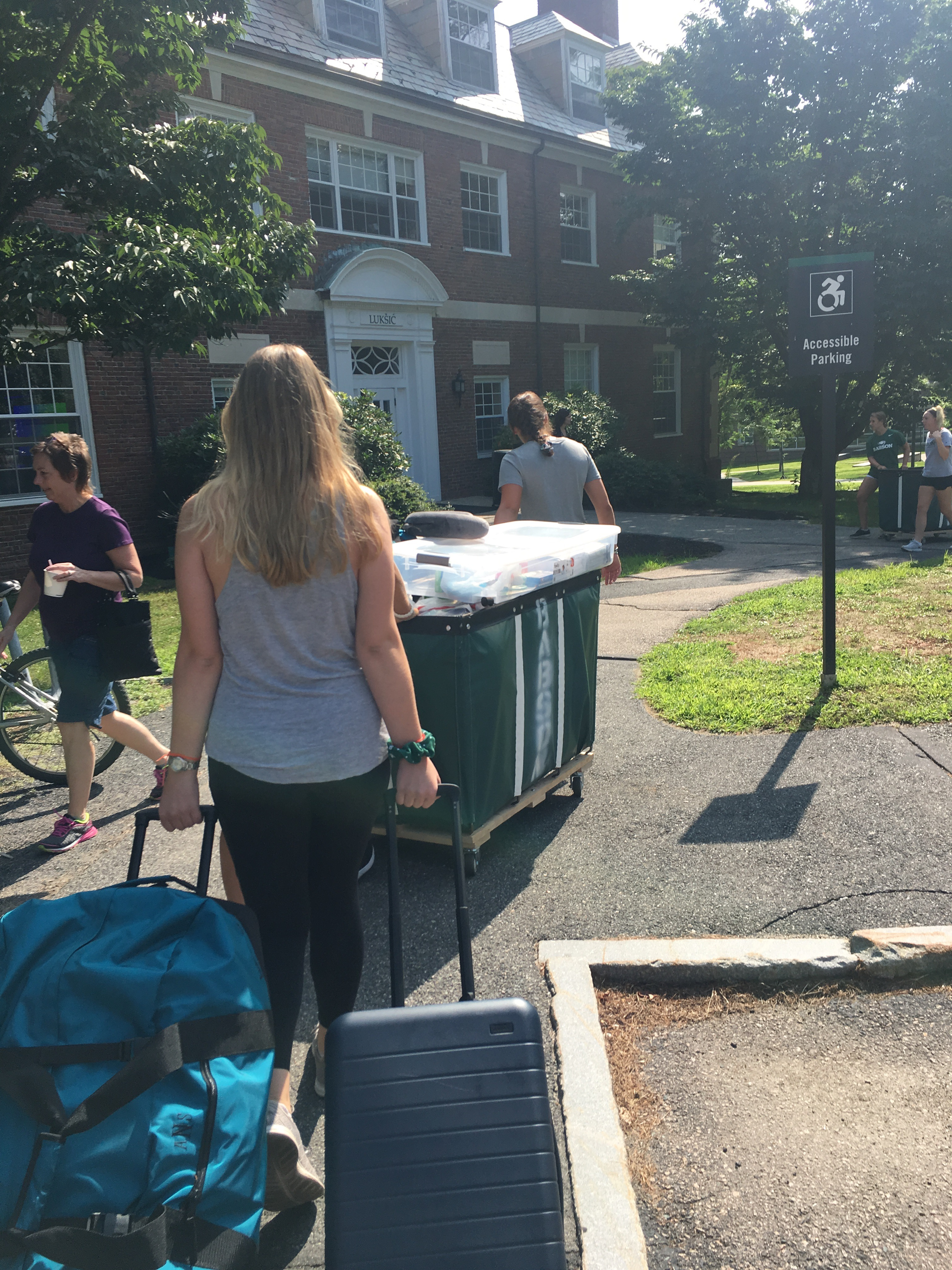 Girl moving into Dorm on College Campus
