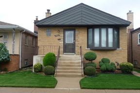 Single Family Home Sold: 6004 Menard Ave.