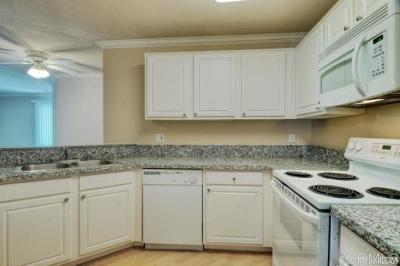 Attached For Sale: 7545 Charmant Drive #1206