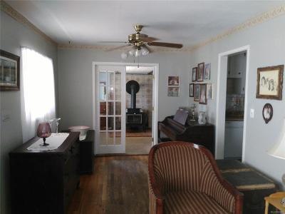 Wheat Ridge CO Single Family Home Active: $245,000