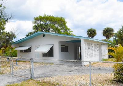 Single Family Home Sold: 211 S Loxahatchee Drive