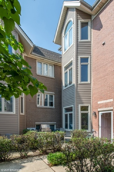 Condo/Townhouse New: 1251 West Fletcher Street #L