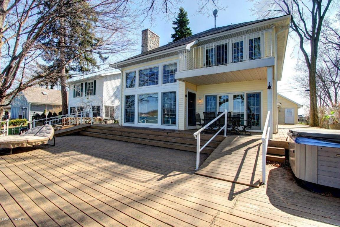 Image is an exterior shot of the described home for sale on Diamond Lake in Cassopolis, Michigan
