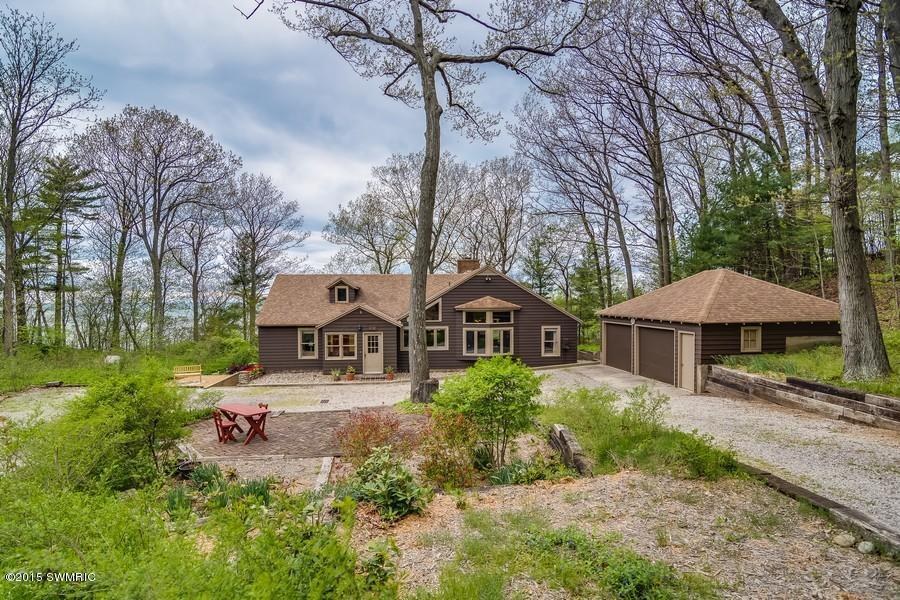 Image is an exterior shot for the described home for sale on Lake Michigan in Coloma